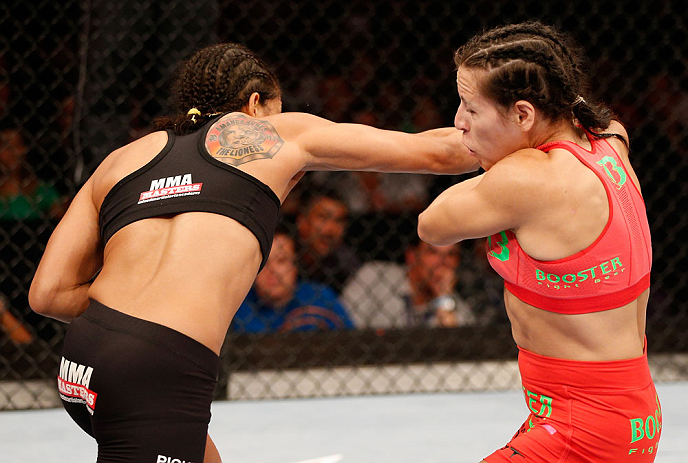 RIO DE JANEIRO, BRAZIL - AUGUST 03:  (L-R) Amanda Nunes punches Sheila Gaff in their women's bantamweight bout during UFC 163 at HSBC Arena on August 3, 2013 in Rio de Janeiro, Brazil. (Photo by Josh Hedges/Zuffa LLC/Zuffa LLC via Getty Images)