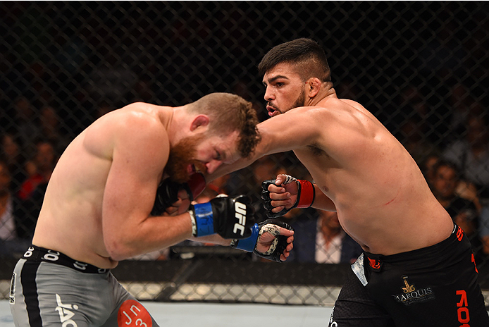 MEXICO CITY, MEXICO - JUNE 13:  (R-L) Kelvin Gastelum of the United States punches Nate Marquardt of the United States in their middleweight bout during the UFC 188 event at the Arena Ciudad de Mexico on June 13, 2015 in Mexico City, Mexico. (Photo by Jos