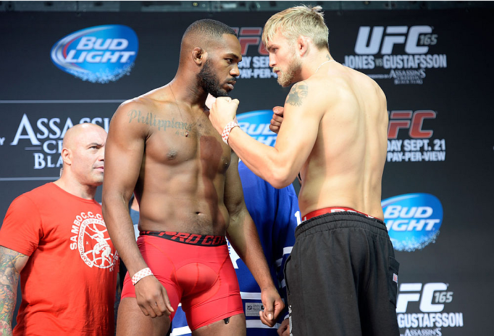 TORONTO, CANADA - SEPTEMBER 20:  (L-R) UFC light heavyweight champion Jon 'Bones' Jones faces off against Alenxander 'The Mauler' Gustafsson during the UFC 165 weigh-in at the Maple Leaf Square on September 20, 2013 in Toronto, Ontario, Canada. Jon Jones