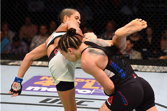 NASHVILLE, TN - AUGUST 08:  (L-R) Amanda Nunes of Brazil attempts a kick against Sara McMann in their women's bantamweight bout during the UFC Fight Night event at Bridgestone Arena on August 8, 2015 in Nashville, Tennessee.  (Photo by Josh Hedges/Zuffa L