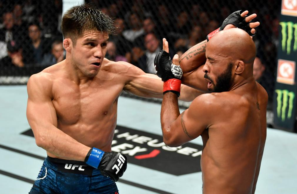 LOS ANGELES, CA - AUGUST 04: (L-R) Henry Cejudo punches Demetrious Johnson in their UFC flyweight championship fight during the UFC 227 event inside Staples Center on August 4, 2018 in Los Angeles, California. (Photo by Jeff Bottari/Zuffa LLC/Zuffa LLC via Getty Images)