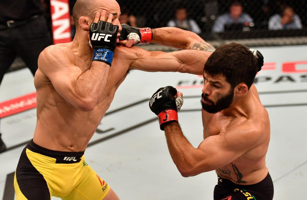 RIO DE JANEIRO, BRAZIL - JUNE 03: (R-L) Raphael Assuncao of Brazil punches Marlon Moraes in their bantamweight bout during the UFC 212 event at Jeunesse Arena on June 3, 2017 in Rio de Janeiro, Brazil. (Photo by Jeff Bottari/Zuffa LLC/Zuffa LLC via Getty Images)
