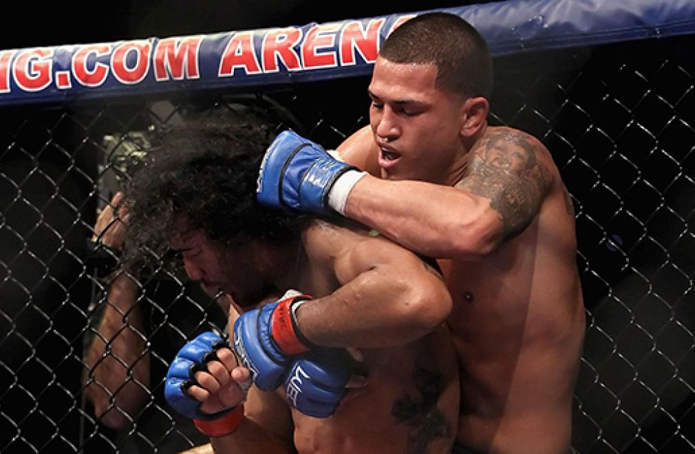 GLENDALE, AZ - DECEMBER 16:  Anthony Pettis (R) fights with Ben Henderson during the Lightweight Title bout at Jobing.com Arena on December 16, 2010 in Glendale, Arizona.  Anthony Pettis won by decesion in the 5th round.  (Photo by Christian Petersen/Zuff