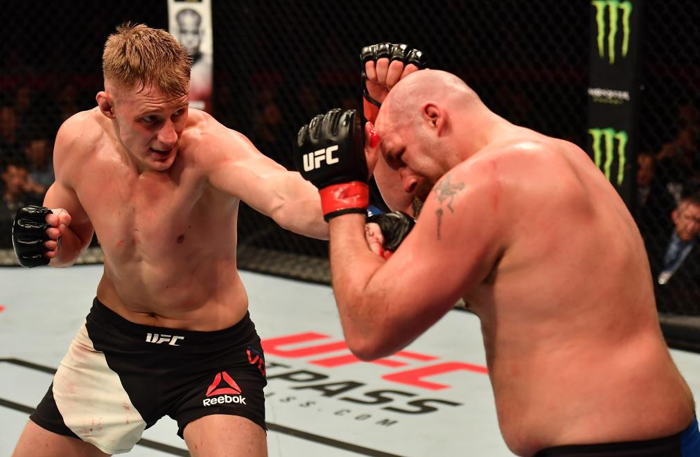 BELFAST, NORTHERN IRELAND - NOVEMBER 19: (L-R) Alexander Volkov of Russia punches Timothy Johnson in their heavyweight bout during the UFC Fight Night at the SSE Arena on November 19, 2016 in Belfast, Northern Ireland. (Photo by Brandon Magnus/Zuffa LLC/Zuffa LLC via Getty Images)
