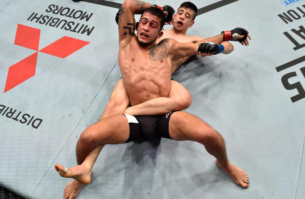 MEXICO CITY, MEXICO - AUGUST 05: Brandon Moreno of Mexico (bottom) controls the body of Sergio Pettis in their flyweight bout during the UFC Fight Night event at Arena Ciudad de Mexico on August 5, 2017 in Mexico City, Mexico. (Photo by Jeff Bottari/Zuffa LLC/Zuffa LLC via Getty Images)
