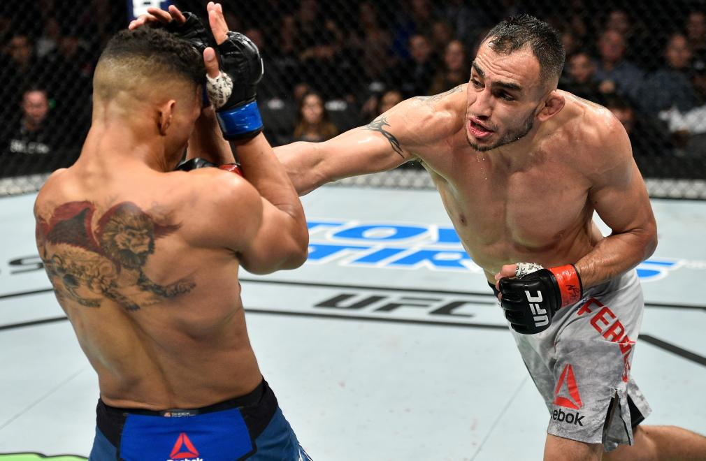 LAS VEGAS, NV - OCTOBER 07: (R-L) Tony Ferguson punches Kevin Lee in their interim UFC lightweight championship bout during the UFC 216 event inside T-Mobile Arena on October 7, 2017 in Las Vegas, Nevada. (Photo by Jeff Bottari/Zuffa LLC/Zuffa LLC via Getty Images)
