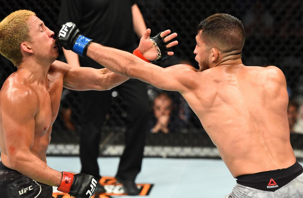 CHICAGO, ILLINOIS - JUNE 09: (R-L) Sergio Pettis punches Joseph Benavidez in their flyweight fight during the UFC 225 event at the United Center on June 9, 2018 in Chicago, Illinois. (Photo by Josh Hedges/Zuffa LLC/Zuffa LLC via Getty Images)