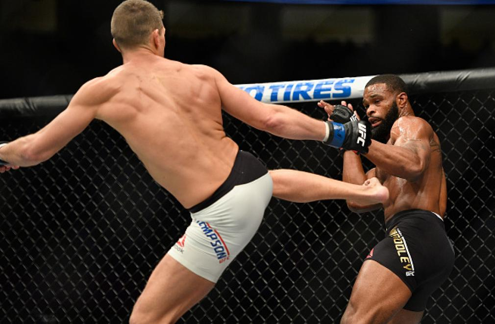 LAS VEGAS, NV - MARCH 04: (L-R) Stephen Thompson kicks Tyron Woodley in their UFC welterweight championship bout during the UFC 209 event at T-Mobile Arena on March 4, 2017 in Las Vegas, Nevada.  (Photo by Jeff Bottari/Zuffa LLC/Zuffa LLC via Getty Images