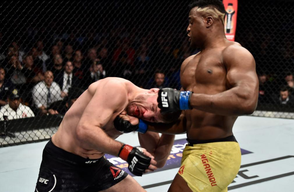 BOSTON, MA - JANUARY 20:  (R-L) Francis Ngannou of Cameroon punches Stipe Miocic in their heavyweight championship bout during the UFC 220 event at TD Garden on January 20, 2018 in Boston, Massachusetts. (Photo by Jeff Bottari/Zuffa LLC/Zuffa LLC via Gett