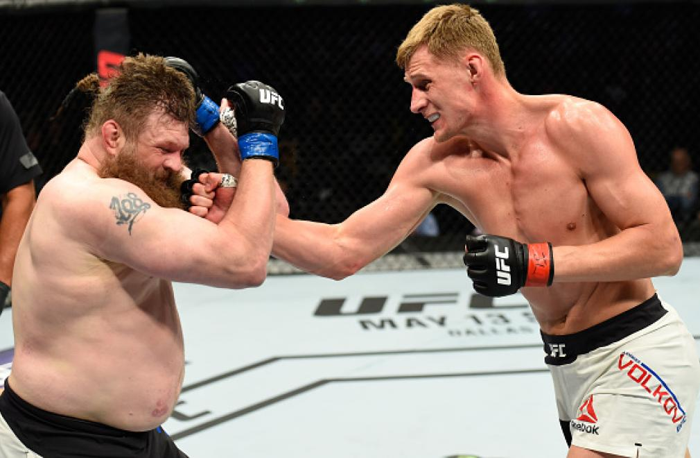 KANSAS CITY, MO - APRIL 15:  (R-L) Alexander Volkov of Russia punches Roy Nelson in their heavyweight fight during the UFC Fight Night event at Sprint Center on April 15, 2017 in Kansas City, Missouri. (Photo by Josh Hedges/Zuffa LLC/Zuffa LLC via Getty I