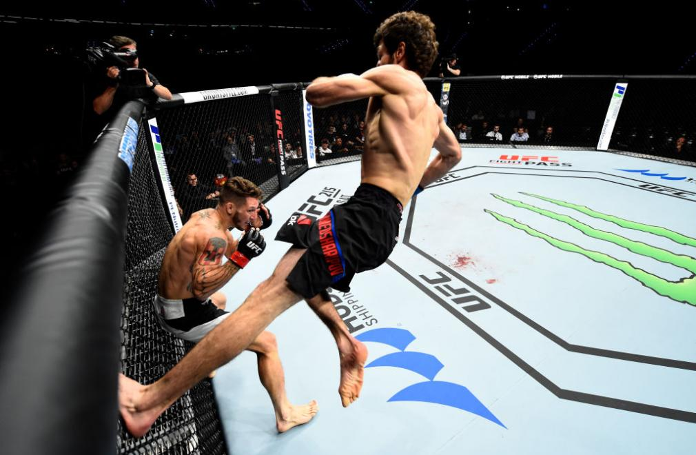 ROTTERDAM, NETHERLANDS - SEPTEMBER 02:  (R-L) Zabit Magomedsharipov of Russia jumps off the wall of the Octagon to kick Mike Santiago in their featherweight bout during the UFC Fight Night event at the Rotterdam Ahoy on September 2, 2017 in Rotterdam, Net