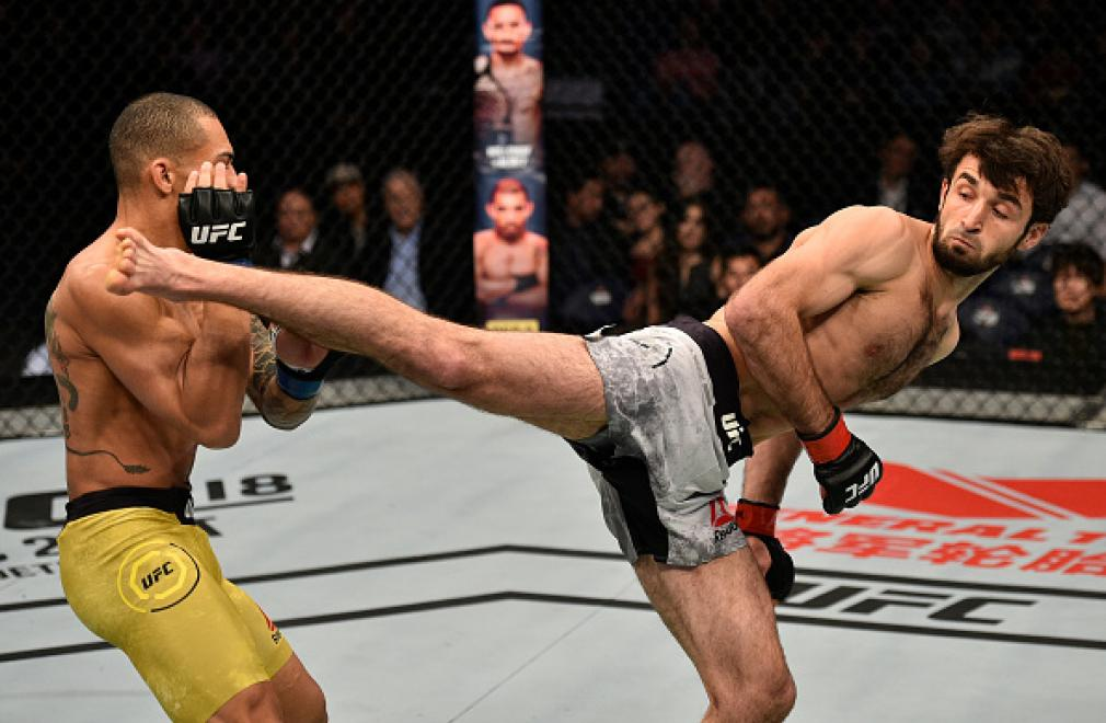 SHANGHAI, CHINA - NOVEMBER 25:  (R-L) Zabit Magomedsharipov of Russia kicks Sheymon Moraes of Brazil in their featherweight bout during the UFC Fight Night event inside the Mercedes-Benz Arena on November 25, 2017 in Shanghai, China. (Photo by Brandon Mag