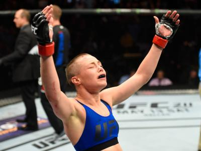 KANSAS CITY, MO - APRIL 15:  Rose Namajunas celebrates her submission victory over Michelle Waterson in their women's strawweight fight during the UFC Fight Night event at Sprint Center on April 15, 2017 in Kansas City, Missouri. (Photo by Josh Hedges/Zuffa LLC via Getty Images)