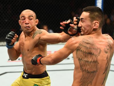 DETROIT, MI - DECEMBER 02:  (L-R) Jose Aldo of Brazil punches Max Holloway in their UFC featherweight championship bout during the UFC 218 event inside Little Caesars Arena on December 02, 2017 in Detroit, Michigan. (Photo by Josh Hedges/Zuffa LLC via Getty Images)