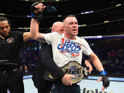 CHICAGO, ILLINOIS - JUNE 09:  UFC President Dana White places the interim welterweight championship belt on Colby Covington after defeating Rafael Dos Anjos of Brazil in their interim welterweight title fight during the UFC 225 event at the United Center on June 9, 2018 in Chicago, Illinois. (Photo by Josh Hedges/Zuffa LLC via Getty Images)