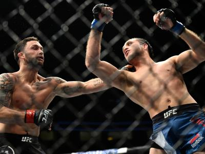 LAS VEGAS, NV - MARCH 03: (R-L) Brian Ortega punches Frankie Edgar in their featherweight bout during the UFC 222 event inside T-Mobile Arena on March 3, 2018 in Las Vegas, Nevada. (Photo by Brandon Magnus/Zuffa LLC/Zuffa LLC via Getty Images)