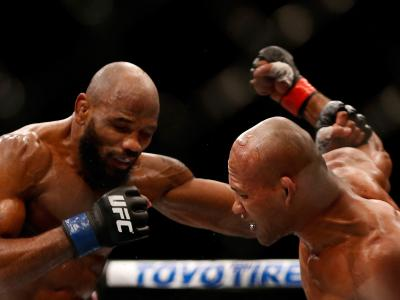 Ronaldo 'Jacare' Souza of Brazil punches Yoel Romero of Cuba in their middleweight bout during the UFC 194 event inside MGM Grand Garden Arena on December 12, 2015 in Las Vegas, Nevada. (Photo by Christian Petersen/Zuffa LLC/Zuffa LLC via Getty Images)