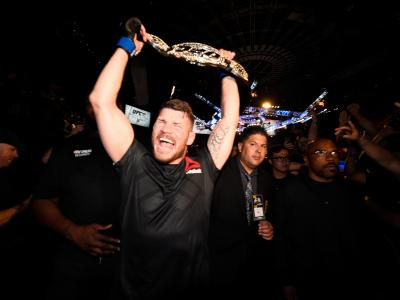 INGLEWOOD, CA - JUNE 04: Michael Bisping of England celebrates with his title belt after his first round knockout win against Luke Rockhold during the UFC 199 event at The Forum on June 4, 2016 in Inglewood, California. (Photo by Jeff Bottari/Zuffa LLC/Zuffa LLC via Getty Images)