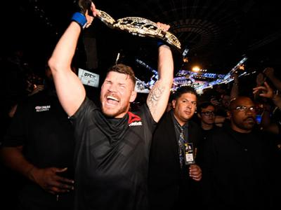 INGLEWOOD, CA - JUNE 04:  Michael Bisping of England celebrates with his title belt after his first round knockout win against Luke Rockhold during the UFC 199 event at The Forum on June 4, 2016 in Inglewood, California.  (Photo by Jeff Bottari/Zuffa LLC/