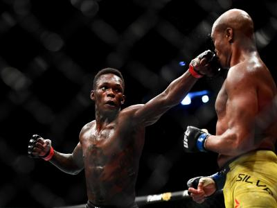 Israel Adesanya of Nigeria punches Anderson Silva of Brazil during their Middleweight bout during UFC234