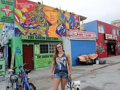 VENICE, CA - OCTOBER 16:  UFC women's bantamweight champion Ronda Rousey poses in front of a mural created in her honor on October 16, 2015 in Venice, California. (Photo by Joshua Blanchard /Zuffa LLC/Zuffa LLC via Getty Images)