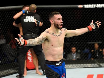 BUFFALO, NY - APRIL 08:  The referee stops the fight as Shane Burgos celebrates his technical knockout victory over Charles Rosa in their featherweight bout during the UFC 210 event at KeyBank Center on April 8, 2017 in Buffalo, New York.  (Photo by Josh
