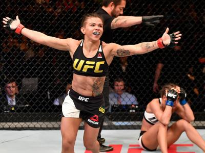 RIO DE JANEIRO, BRAZIL - JUNE 03:  Claudia Gadelha of Brazil celebrates after her submission victory over Karolina Kowalkiewicz of Poland in their womens strawweight bout during the UFC 212 event at Jeunesse Arena on June 3, 2017 in Rio de Janeiro, Brazil