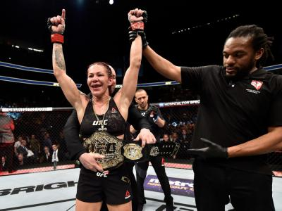 LAS VEGAS, NV - DECEMBER 30:  Cris Cyborg of Brazil celebrates after her unanimous-decision victory over Holly Holm in their women's featherweight bout during the UFC 219 event inside T-Mobile Arena on December 30, 2017 in Las Vegas, Nevada. (Photo by Jef