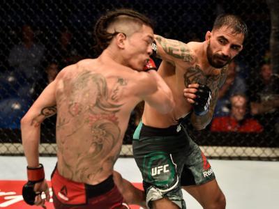 PERTH, AUSTRALIA - FEBRUARY 11:  (R-L) Jose Quinonez of Mexico punches Teruto Ishihara of Japan in their bantamweight bout during the UFC 221 event at Perth Arena on February 11, 2018 in Perth, Australia. (Photo by Jeff Bottari/Zuffa LLC/Zuffa LLC via Get