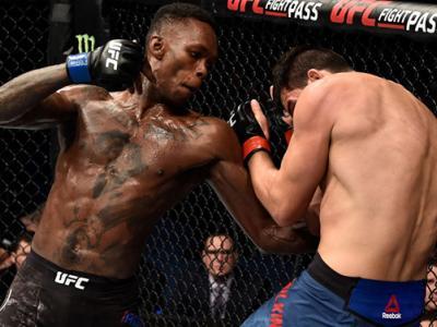 PERTH, AUSTRALIA - FEBRUARY 11:  (L-R) Israel Adesanya of Nigeria punches Rob Wilkinson of Australia in their middleweight bout during the UFC 221 event at Perth Arena on February 11, 2018 in Perth, Australia. (Photo by Jeff Bottari/Zuffa LLC/Zuffa LLC vi