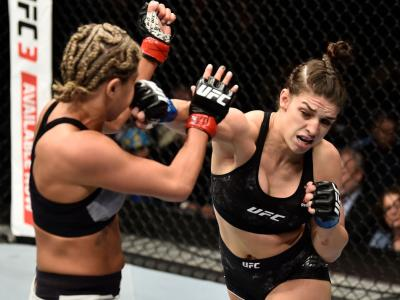 LAS VEGAS, NV - MARCH 03:   (R-L) Mackenzie Dern punches Ashley Yoder in their women's strawweight bout during the UFC 222 event inside T-Mobile Arena on March 3, 2018 in Las Vegas, Nevada. (Photo by Jeff Bottari/Zuffa LLC/Zuffa LLC via Getty Images)