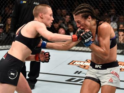 BROOKLYN, NEW YORK - APRIL 07:  (L-R) Rose Namajunas punches Joanna Jedrzejczyk of Poland in their women's strawweight title bout during the UFC 223 event inside Barclays Center on April 7, 2018 in Brooklyn, New York. (Photo by Jeff Bottari/Zuffa LLC/Zuff
