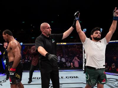 RIO DE JANEIRO, BRAZIL - MAY 12: Kelvin Gastelum (R) of the United States celebrates victory over Ronaldo Souza of Brazil in their middleweight bout during the UFC 224 event at Jeunesse Arena on May 12, 2018 in Rio de Janeiro, Brazil. (Photo by Buda Mende