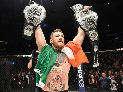 NEW YORK, NY - NOVEMBER 12:  UFC lightweight and featherweight champion Conor McGregor of Ireland celebrates after defeating Eddie Alvarez in their UFC lightweight championship fight during the UFC 205 event at Madison Square Garden on November 12, 2016 i