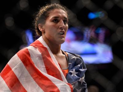 LAS VEGAS, NV - JULY 08:  Tatiana Suarez celebrates after her submission victory over Amanda Cooper in their women's strawweight bout during The Ultimate Fighter Finale event at MGM Grand Garden Arena on July 8, 2016 in Las Vegas, Nevada.  (Photo by Brand