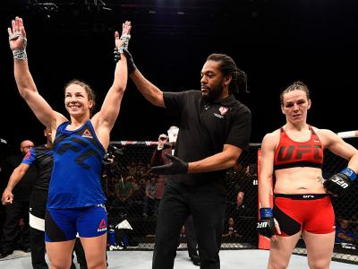 LAS VEGAS, NV - DECEMBER 03: Sara McMann celebrates after her submission victory over Alexis Davis of Canada during The Ultimate Fighter Finale event inside the Pearl concert theater at the Palms Resort & Casino on December 3, 2016 in Las Vegas, Nevada. (
