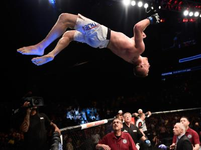 LAS VEGAS, NV - JULY 07:  Justin Gaethje celebrates by doing a backflip off the Octagon after defeating Michael Johnson in their lightweight bout during The Ultimate Fighter Finale at T-Mobile Arena on July 7, 2017 in Las Vegas, Nevada.  (Photo by Brandon