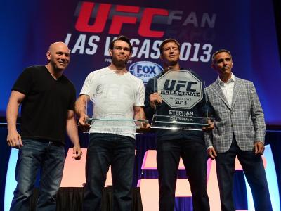 LAS VEGAS, NV - JULY 06:  UFC president Dana White (L) and television producer Craig Piligian (R) present Forrest Griffin (2nd left) and Stephan Bonnar (2nd right) with their UFC Hall of Fame plaques during the UFC Fan Expo Las Vegas 2013 at the Mandalay