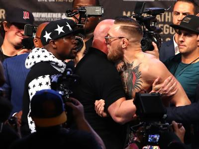 NEW YORK, NY - JULY 13:  Floyd Mayweather Jr. and Conor McGregor face off during the Floyd Mayweather Jr. v Conor McGregor World Press Tour event at Barclays Center on July 13, 2017 in the Brooklyn borough of New York City.  (Photo by Mike Lawrie/Getty Im