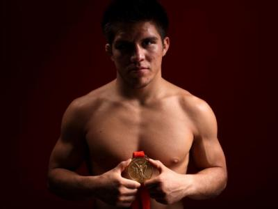 BEIJING - AUGUST 20:  Henry Cejudo of the United States poses with his gold medal in the NBC Today Show Studio after winning the Men's 55kg Freestyle Wrestling at the Beijing 2008 Olympic Games on August 20, 2008 in Beijing, China.  (Photo by Kristian Dow