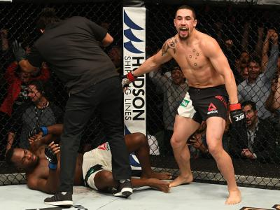 MELBOURNE, AUSTRALIA - NOVEMBER 27:   Robert Whittaker of New Zealand celebrates his TKO victory over Derek Brunson in their middleweight bout during the UFC Fight Night event at Rod Laver Arena on November 27, 2016 in Melbourne, Australia. (Photo by Jeff