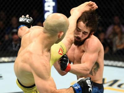UTICA, NY - JUNE 01:  (L-R) Marlon Moraes of Brazil kicks Jimmie Rivera in the head in their bantamweight fight during the UFC Fight Night event at the Adirondack Bank Center on June 1, 2018 in Utica, New York. (Photo by Josh Hedges/Zuffa LLC/Zuffa LLC vi
