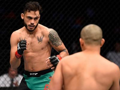 MEXICO CITY, MEXICO - NOVEMBER 05:  (L-R) Marco Beltran of Mexico circles Joe Soto of the United States in their catchweight bout during the UFC Fight Night event at Arena Ciudad de Mexico on November 5, 2016 in Mexico City, Mexico. (Photo by Jeff Bottari