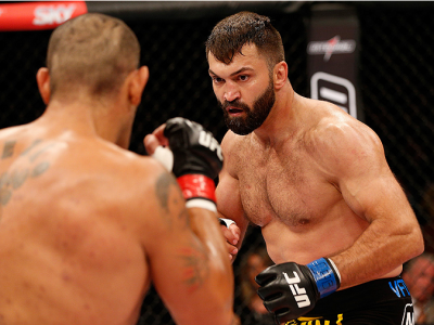 """BRASILIA, DF - SEPTEMBER 13: (R-L) Andrei Arlovski of Belarus squares off with Antonio """"Bigfoot"""" Silva of Brazil in their heavyweight bout during the UFC Fight Night event inside Nilson Nelson Gymnasium on September 13, 2014 in Brasilia, Brazil. (Photo by"""