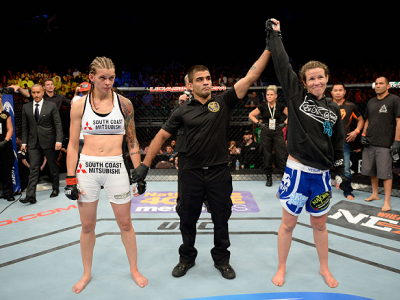 ATLANTIC CITY, NJ - JULY 16: (R-L) Leslie Smith celebrates after defeating Jessamyn Duke in their women's bantamweight bout during the UFC Fight Night event at Revel Casino on July 16, 2014 in Atlantic City, New Jersey. (Photo by Jeff Bottari/Zuffa LLC/Zu